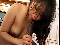 Asian broad puffs cigarette while deep throating cock