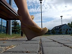 wifes pantyhosed feet in pumps, candid shoeplay
