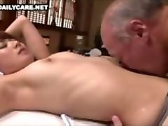 japanese old man licks young woman's belly.