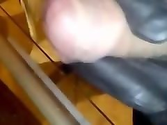 jerking my tiny cock with black leather gloves.