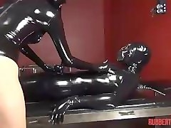 rubber catsuit and rebreathing mask. fucked w strapon