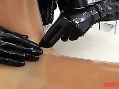 rubber babe in condom suit fucked w huge strapon by catsuit babe