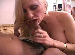 Blonde milf sucking black cock.
