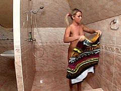 oiled up blonde babe oils up and masturbates during a shower