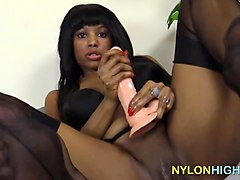 ebony naida inserts this big dildo