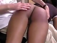Ebony spanked with hand and paddle
