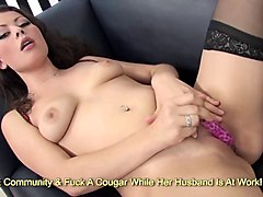 sultry brunette masturbates furiously on couch