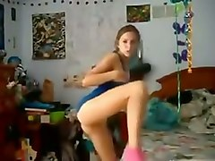 brunette nympho in blue tank top was fingering herself in standing pose