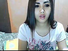 cute long straight haired and leggy brunette ladyboy was posing on webcam