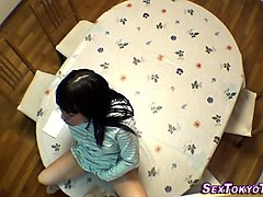 asian teen riding toy
