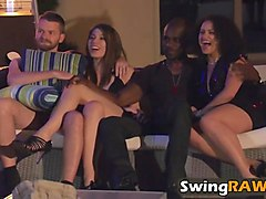 mature couple having fun with young studs and girl in swinger reality show