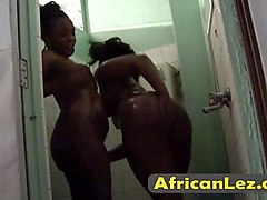 slutty african whores having lesbo fun under the shower