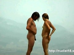 nude beach voyeur shot of two hot brunettes sunbathing