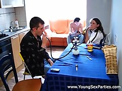 Young Sex Parties - Two young couples fuck on a kitchen table