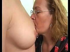 Mature lesbian teaching a young lesbian how to use a dildo
