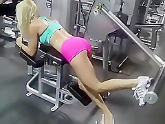Hot blonde babe exercising in the gym