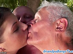 two young beauties are getting screwed by an old grandpa outdoors in several poses and eat his warm cum