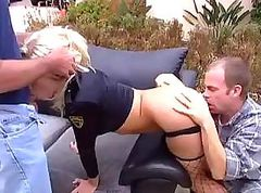 Blonde takes a cock in each end in this outdoor threesome
