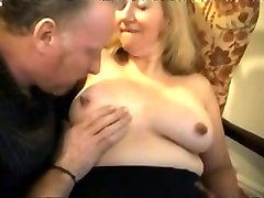 busty blonde granny teases with her big tits and sucks dick