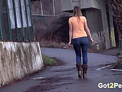 busty european sweetheart in tight blue jeans pees on the street