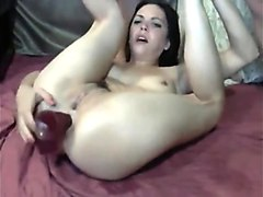 while she fucks her mouth she also dildos her ass