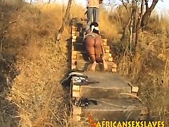 african slave enjoys getting tortured outdoors